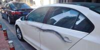 停在小区内的14辆私家车一夜之间破相 - Syd.Com.Cn